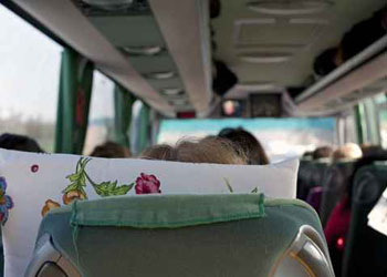 Tourists in a luxury chartered bus on road during a tour